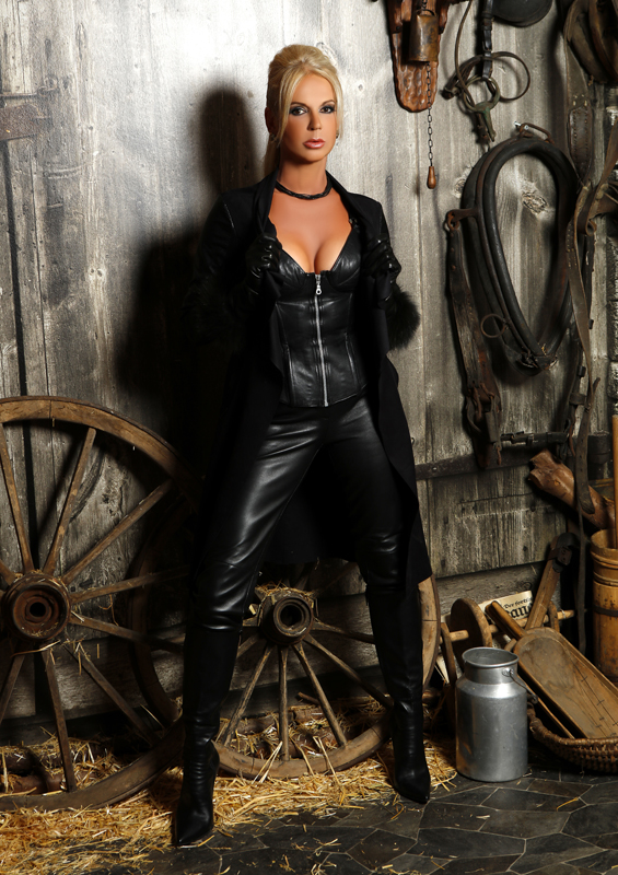 The mistress in a leather corset smokes sitting on the back of her husband wwwlifecamgirlscom - 2 3